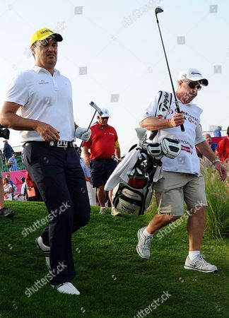 Simon Khan (l) of England Walks with His Caddie During the Final Round of the Commercial-bank Qatar Masters Golf Tournament at the Doha Golf Club in Doha Qatar 26 January 2013 Qatar Doha