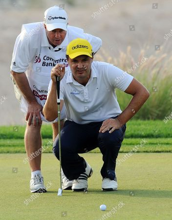 England's Simon Khan Lines Up a Putt During the Final Round of the Commercial-bank Qatar Masters Golf Tournament at the Doha Golf Club in Doha Qatar 26 January 2013 Qatar Doha