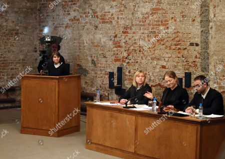 Pussy Riot's Yekaterina Samutsevich (l) Sits on the Stand During the Video Recording of the Theater Project 'Moscow Trials' at the Sacharow Centre in Moscow Russia 03 March 2013 the Theater Project by Swiss Director Milo Rau and the International Institute of Political Murder Re-enacts the Trial Against Russian Punk Band Pussy Riot and Continues Until 03 March Three Members of Pussy Riot Were Found Guilty of Hooliganism Motivated by Religious Hatred in August 2012 For the Group's Performance at the Christ the Savior Cathedral in Moscow Russia Russian Federation Moscow