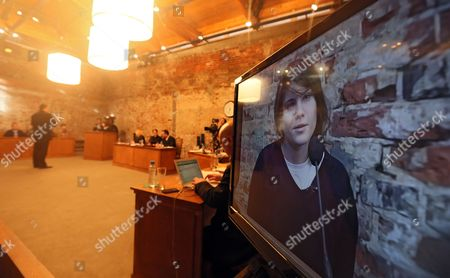 Pussy Riot's Yekaterina Samutsevich (r on Screen) Sits on the Stand During the Video Recording of the Theater Project 'Moscow Trials' at the Sacharow Centre in Moscow Russia 03 March 2013 the Theater Project by Swiss Director Milo Rau and the International Institute of Political Murder Re-enacts the Trial Against Russian Punk Band Pussy Riot and Continues Until 03 March Three Members of Pussy Riot Were Found Guilty of Hooliganism Motivated by Religious Hatred in August 2012 For the Group's Performance at the Christ the Savior Cathedral in Moscow Russia Russian Federation Moscow
