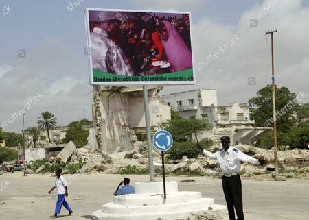 A Somali Boy Walks Past a Campaign Billboard of Incumbent President Sharif Sheikh Ahmed Reading 'Vote Carefully For Justice' in the Capital Mogadishu Somalia 09 September 2012 a Day Before the Somali Lawmakers Are Scheduled to Elect the Country's New President Somalia's New Parliament That was Created Last Month Will Hold a Ballot on 10 September 2012 to Choose the Country's New President From 25 Candidates Including the Incumbent President Sharif Sheikh Ahmed and the Prime Minister Abdiweli Mohamed Ali Somalia Mogadishu