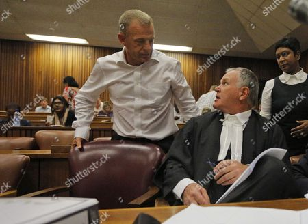 State Prosecutor Gerrie Nel (l) Talks to Oscar Pistorius Defense Team Leader Barry Roux (r) During the Bail Hearing of Murder Suspect Oscar Pistorius in Pretoria South Africa 28 March 2013 Pistorius Did not Appear in Court the Case is Postponed Until 04 June 2013 South Africa Pretoria
