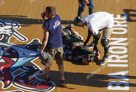 Professional Skateboarder Bob Burnquist From Brazil (r) Attends to Danny Mayer From the Usa After He Wiped out on the Mega Ramp Colliding with the Edge of the Ramp During the 2012 Skateboarding World Championships Maloof Money Cup in Kimberley South Africa 29 September 2012 the World's Best Skateboarders Are Competing For the Biggest Cash Prize in Skateboarding in the Three Disciplines of Street Vert and Mega Ramp the Maloof Money Cup South Africa Skate Park is Built Next to the Famous Kimberley Diamond Mine and is a New Destination For Skateboarders Around the World As Well As Being a Centre For Youth Development and Community Upliftment Through the Skate For Hope Programme Initiated by the Us Hotel Property Ticoons the Maloof Brothers South Africa Kimberley