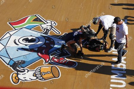 Professional Skateboarder Bob Burnquist From Brazil (2-r) Attends to Danny Mayer From the Usa After He Wiped out on the Mega Ramp Colliding with the Edge of the Ramp During the 2012 Skateboarding World Championships Maloof Money Cup in Kimberley South Africa 29 September 2012 the World's Best Skateboarders Are Competing For the Biggest Cash Prize in Skateboarding in the Three Disciplines of Street Vert and Mega Ramp the Maloof Money Cup South Africa Skate Park is Built Next to the Famous Kimberley Diamond Mine and is a New Destination For Skateboarders Around the World As Well As Being a Centre For Youth Development and Community Upliftment Through the Skate For Hope Programme Initiated by the Us Hotel Property Ticoons the Maloof Brothers South Africa Kimberley