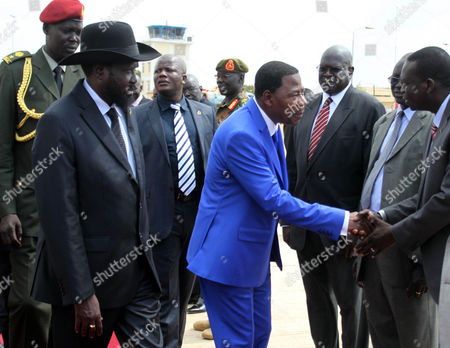 President of Benin Thomas Yayi Boni (c) Accomnpagnied with His South Sudanese Counterpart Salva Kiir (2-l) Checks Hands with South Sudanese Officials Upon His Arrival Atl Juba Airport South Sudan 17 January 2013 Boni is in South Sudan to Hold Talk with His South Sudanese Counterpart Ahead a Next African Union Summit Media Reports State on 17 January South Sudan Started to Withdraw Troops From His Disputed Border with Sudan South Sudan Juba