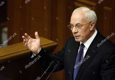 Mykola Azarov the Newly Elected Ukrainian Prime Minister Speaks to Lawmakers in the Ukrainian Parliament in Kiev Ukraine 13 December 2012 Ukraine's Prime Minister Nikolai Azarov Won Another Term 13 December Hours After Lawmakers Brawled in the Chamber and Weeks After an Election the Opposition Says was Marred by Vote-rigging the Opposition Accuses Azarov 64 of Economic Mismanagement and Says He is the Wrong Man As Ukraine Next Year Takes the Presidency of the Organization For Security and Cooperation in Europe (osce) Members of the Party of the Jailed Opposition Leader Former Premier Yulia Tymoshenko on 13 December Traded Punches with Deputies of Azarov's Regions Party Throwing the Chamber Into Turmoil the Violence Came at a Time when Western Countries Have Voiced Concern Over the State of Democracy in Ukraine and Have Labelled the Seven-year Jail Term For Tymoshenko Politically Motivated Ukraine Kiev