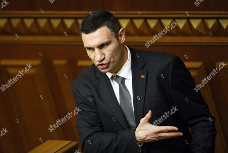 Heavy Weight World Boxing Champion and Leader of the Udar (punch) Party Vitaliy Klitschko Speaks During a Session of the Ukrainian Parliament in Kiev Ukraine 13 December 2012 Ukraine's Prime Minister Nikolai Azarov Won Another Term 13 December Hours After Lawmakers Brawled in the Chamber and Weeks After an Election the Opposition Says was Marred by Vote-rigging the Opposition Accuses Azarov 64 of Economic Mismanagement and Says He is the Wrong Man As Ukraine Next Year Takes the Presidency of the Organization For Security and Cooperation in Europe (osce) Members of the Party of the Jailed Opposition Leader Former Premier Yulia Tymoshenko on 13 December Traded Punches with Deputies of Azarov's Regions Party Throwing the Chamber Into Turmoil the Violence Came at a Time when Western Countries Have Voiced Concern Over the State of Democracy in Ukraine and Have Labelled the Seven-year Jail Term For Tymoshenko Politically Motivated Ukraine Kiev