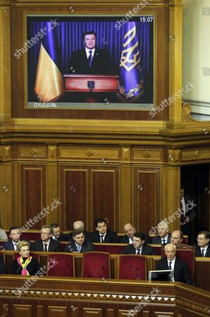 Mykola Azarov (r-down) the Newly Elected Ukrainian Prime Minister Listens a Televised Speech of President Viktor Yanukovych in the Ukrainian Parliament in Kiev Ukraine 13 December 2012 Ukraine's Prime Minister Nikolai Azarov Won Another Term 13 December Hours After Lawmakers Brawled in the Chamber and Weeks After an Election the Opposition Says was Marred by Vote-rigging the Opposition Accuses Azarov 64 of Economic Mismanagement and Says He is the Wrong Man As Ukraine Next Year Takes the Presidency of the Organization For Security and Cooperation in Europe (osce) Members of the Party of the Jailed Opposition Leader Former Premier Yulia Tymoshenko on 13 December Traded Punches with Deputies of Azarov's Regions Party Throwing the Chamber Into Turmoil the Violence Came at a Time when Western Countries Have Voiced Concern Over the State of Democracy in Ukraine and Have Labelled the Seven-year Jail Term For Tymoshenko Politically Motivated Ukraine Kiev
