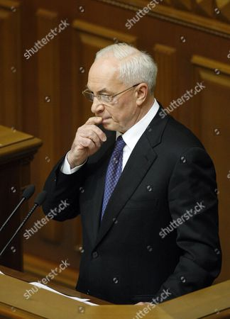 Mykola Azarov the Newly Elected Ukrainian Prime Minister Gestures As He Speaks to Lawmakers in the Ukrainian Parliament in Kiev Ukraine 13 December 2012 Ukraine's Prime Minister Nikolai Azarov Won Another Term 13 December Hours After Lawmakers Brawled in the Chamber and Weeks After an Election the Opposition Says was Marred by Vote-rigging the Opposition Accuses Azarov 64 of Economic Mismanagement and Says He is the Wrong Man As Ukraine Next Year Takes the Presidency of the Organization For Security and Cooperation in Europe (osce) Members of the Party of the Jailed Opposition Leader Former Premier Yulia Tymoshenko on 13 December Traded Punches with Deputies of Azarov's Regions Party Throwing the Chamber Into Turmoil the Violence Came at a Time when Western Countries Have Voiced Concern Over the State of Democracy in Ukraine and Have Labelled the Seven-year Jail Term For Tymoshenko Politically Motivated Ukraine Kiev