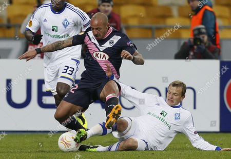 Julien Faubert (c) of Bordeaux Vies For the Ball with Oleh Gusev (r) of Dynamo During the Uefa Europa League Round of 32 First Leg Soccer Match Between Dynamo Kyiv and Girondins De Bordeaux at the Olimpiyskiy Stadium in Kiev Ukraine 14 February 2013 Ukraine Kiev