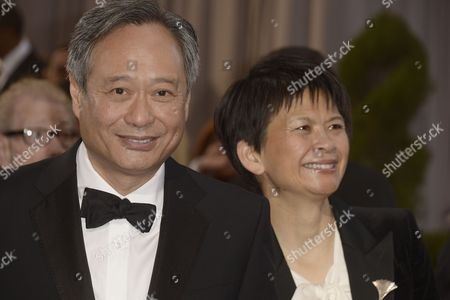 Chinese Director Ang Lee and His Wife Jane Lin (r) Arrive on the Red Carpet For the 85th Academy Awards at the Dolby Theatre in Hollywood California Usa 24 February 2013 the Oscars Are Presented For Outstanding Individual Or Collective Efforts in Up to 24 Categories in Filmmaking United States Hollywood