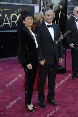 Taiwanese-born Us Director Ang Lee (r) and His Wife Jane Lin Arrive For the 85th Academy Awards in Hollywood California Usa 24 February 2013 the Oscars Are Presented For Outstanding Individual Or Collective Efforts in Up to 24 Categories in Filmmaking United States Hollywood