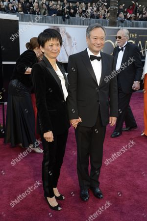 Taiwanese-born Us Director Ang Lee (r) and Wife Jane Lin Arrive For the 85th Academy Awards in Hollywood California Usa 24 February 2013 the Oscars Are Presented For Outstanding Individual Or Collective Efforts in Up to 24 Categories in Filmmaking United States Hollywood