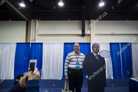 Terrence Scout (c) Has His Picture Made with a Cardboard Cutout of Karl Rove (r) at the 40th Annual Conservative Political Action Conference (cpac) at the Gaylord National Resort & Convention Center in National Harbor Maryland Usa 14 March 2013 United States National Harbor