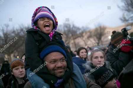 Kennedi Franklin 8 Cheers As She Sits on the Shoulders of Her Father Edward Franklin of Mobile Alabama As They Wait on National Mall For Ceremonies to Start Prior to President Barack Obama Being Ceremonially Sworn in For a Second Term As the 44th President of the United States in Washington Dc Usa 21 January 2013 United States Washington