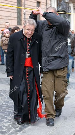 Police Officer Escorts German Cardinal Walter Kasper While He Leaves the Vatican Vatican City 15 March 2013 Newly Elected Pope Francis is Set to Deliver His First Angelus Prayers on Sunday and Be Inaugurated with a Mass in Saint Peter's Square 19 March Which Many World Leaders Are Expected to Attend Including Argentinian President Cristina Fernandez De Kirchner Vatican City State (holy See) Vatican City
