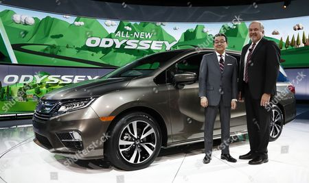 Stock Image of Takahiro Hachigo, President and CEO Honda Motor Company (L) along with John Mendel, Executive Vice President American Honda Motor Company (R) in front of the new Odyssey mini van at the North American International Auto Show, at the Cobo Center in Detroit, Michigan, USA, 09 January 2017.The automobile show opened on 08 January and will last until 22 January with the show being opened to the public from 14 January on.