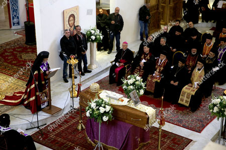Patriarch of Antioch and All the East for Roman Catholics Gregory III Laham (L) and a gathering of bishops pray next to the coffin of Bishop of Jerusalem in exile and Patriarchal Vicar of Jerusalem Hilarion Capucci during a funeral held at Our Lady of the Annunciation Church Batrerkah in Rabweh, Northeast Beirut, Lebanon, 09 January 2017. Bishop Hilarion Capucci died at the age of 94 on 01 January 2017 in the Holy Vatican City, Rome.