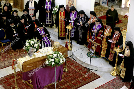 Stock Picture of Patriarch of Antioch and All the East for Roman Catholics Gregory III Laham (C- R) and a gathering of bishops pray next to the coffin of Bishop of Jerusalem in exile and Patriarchal Vicar of Jerusalem Hilarion Capucci during a funeral held at Our Lady of the Annunciation Church Batrerkah in Rabweh, Northeast Beirut, Lebanon, 09 January 2017. Bishop Hilarion Capucci died at the age of 94 on 01 January 2017 in the Holy Vatican City, Rome.