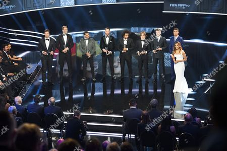 (L-R) Host Marco Schreyl, winners of the FIFA FIFPro World11 Manuel Neuer (Germany, Bayern Munich), Dani Alves (Brazil, FC Barcelona and Juventus FC), Sergio Ramos (Spain, Real Madrid), Marcelo (Brazil, Real Madrid), Luka Modric (Croatia, Real Madrid), Toni Kroos (Germany, Real Madrid), Cristiano Ronaldo (Portugal, Real Madrid) and host Eva Longoria attend the FIFA Awards 2016 gala at the Swiss TV studio in Zurich, Switzerland, 09 January 2017. The best soccer player of 2016 will be chosen during the ceremony.