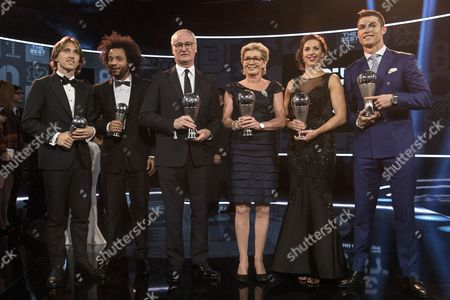 (L-R) Real Madrid players Luka Modric and Marcelo, Leicester City's Italian manager Claudio Ranieri, former German women's national soccer team head coach Silvia Neid, US soccer player Carli Lloyd of Houston Dash, and Real Madrid's Portuguese striker Cristiano Ronaldo pose with their trophies during the FIFA Awards 2016 gala at the Swiss TV studio in Zurich, Switzerland, 09 January 2017.