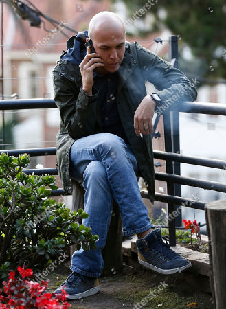 Colombia's film Director Cesar Augusto Acevedo speaks on the phone before an interview in Bogota, Colombia, . Acevedo won the Camera d'Or award for La Tierra y la Sombra film during the 68th Cannes Film Festival
