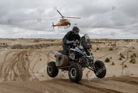 Gustavo Gallego, of Argentina, rides his Yamaha quad during the 7th stage of the Dakar Rally between Oruro and Uyuni, Bolivia, . The race started in Paraguay and passes through Argentina as well