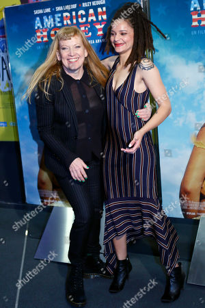 Director Andrea Arnold, left, and actress Sasha Lane pose during a photo call for the French premiere of the film 'American Honey' in Paris