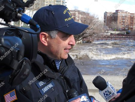 FLOODS Nevada Gov. Brian Sandoval talks to reporters, in Reno, Nev., atop one of the downtown bridges across the Truckee River that remained closed after the floodwaters crested earlier in the day. Another storm was in the forecast Tuesday but city officials said it should be a colder snow system and that the threat of flooding had passed