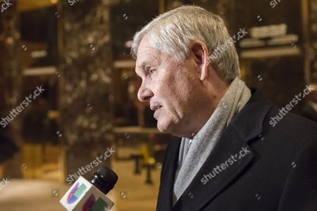 Univision CEO Randy Falco is seen speaking with the press in the lobby of Trump Tower