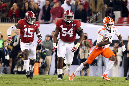 , 2017; Tampa, FL, USA; Alabama Crimson Tide defensive back Ronnie Harrison (15) and Alabama Crimson Tide defensive lineman Dalvin Tomlinson (54) pursue Clemson Tigers wide receiver Deon Cain (8) during the first half of the NCAA CFP National Championship football game between Clemson Tigers and Alabama Crimson Tide at Raymond James Stadium. Clemson defeated Alabama 35-31