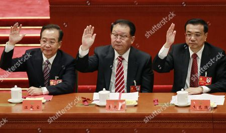 Stock Picture of Chinese Premier Wen Jiabao (l) Propaganda Chief Li Changchun (c) and Vice-premier Li Keqiang Raise Their Right Hand to Show Approval of a Work Report During the Closing Ceremony of the 18th Cpc (communist Party Congress) in Beijing China 14 November 2012 the Cpc is Expected to Introduce the New Leadership Lineup and the Standing Committee of the Politburo on 15 November a Day After the Closing China Beijing