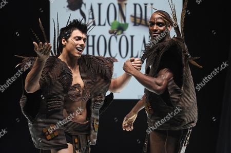 French Sportsman Ronald Pognon (r) and Taig Khris (l) Present Creations Made of Chocolate by Designer Lea Larcheveque and Chocolate Manufacturer Patrice Chapon During a Fashion Show As Part of the Chocolate Show in Paris France 30 October 2012 the 18th Salon Du Chocolat Runs From 31 to 04 November 2012 France Paris