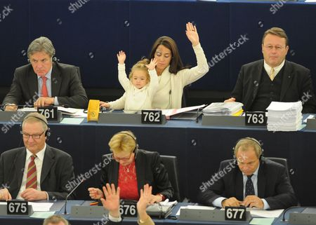 Licia Ronzulli (up C) Italian Member of the European Parliament and Her Daughter Vittoria Take Part in a Voting Session in the European Parliament in Strasbourg France 23 October 2012 Other Delegates Are not Identified France Strasbourg