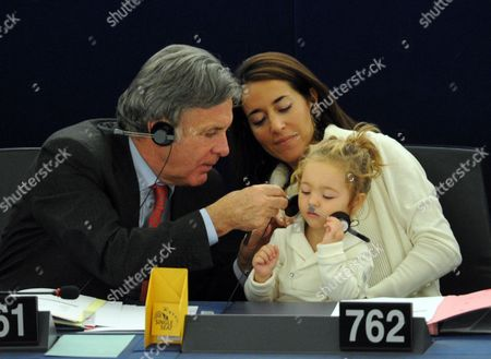 Licia Ronzulli (c) Italian Member of the European Parliament and Her Daughter Vittoria (r) Take Part in a Voting Session in the European Parliament in Strasbourg France 23 October 2012 Delegate on Left is not Identified France Strasbourg