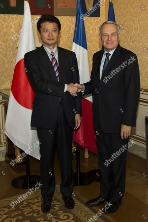French Prime Minister Jean-marc Ayrault (r) Greets Japanese Foreign Affairs Minister Koichiro Gemba (l) As He Arrives For a Meeting at Matignon in Paris France 16 October 2012 France Paris