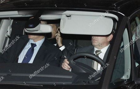 A Car with Former French President Nicolas Sarkozy (back L) and His Lawyer Thierry Herzog (back R) Leave the Tribunal of Bordeaux France 22 November 2012 Former French President Nicolas Sarkozy Spent the Day 22 November 2012 Being Quizzed by Investigating Magistrates in the City of Bordeaux Over Allegations He Received Illegal Campaign Donations From a Billionaire Cosmetics Heiress Sarkozy 57 is Alleged to Have Received Cash-stuffed Envelopes Towards His 2007 Election Campaign From L'oreal Heiress Liliane Bettencourt Either Directly Or Through Intermediaries the Donations Allegedly Amounted to 150 000 Euros (191 982 Euros) - Far More Than the 4 600 Euros in Individual Contributions Permitted Under French Law France Bordeaux
