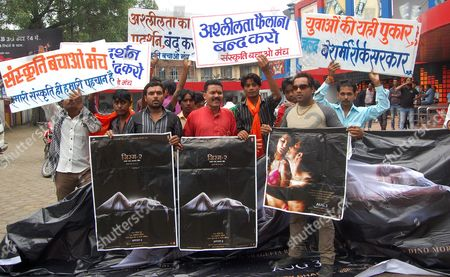 Stock Picture of Activists of Sanskriti Bachao Manch a Hindu Culture Hardline Organisation Hold Posters of Bollywood Movie Jism-2 Before Burning Them During a Protest Outside a Cinema Hall on the First Day of the Release of the Movie in Bhopal India 03 August 2012 Jism 2 Has Been Passed with an A-certificate by the Central Board of Film Certification (cbfc) the Film Directed by Pooja Bhatt is the Sequel to the 2003 Film Jism and Marks the Debut of Indo-canadian Pornographic Actress Sunny Leone the Protesters Alleged That the Movie is Against Indian Culture and Should not Be Released India Bhopal