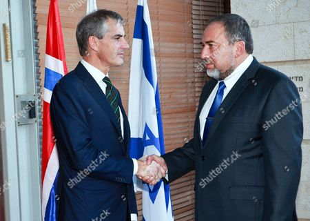 Stock Picture of Norwegian Foreign Minister Jonas Gahr Stoere (l) and His Host Israeli Foreign Minister Avigdor Lieberman (r) Stop For a Hand Shake Outside the Foreign Ministry in Jerusalem Israel 05 September 2012 As He Arrives For Talks Israel Jerusalem