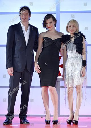 Stock Image of Ukrainian-born Us Actress/cast Member Milla Jovovich (c) Her Husband British Director Paul W S Anderson (l) and Japanese Actress Mika Nakashima (r) Pose on Stage During the World Premiere of 'Resident Evil: Retribution' in Tokyo Japan 03 September 2012 the Latest Installment of the Resident Evil Movie Series Will Be Screened in Japanese Theatres From 14 September on Japan Tokyo
