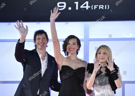 Ukrainian-born Us Actress/cast Member Milla Jovovich (c) Her Husband British Director Paul W S Anderson (l) and Japanese Actress Mika Nakashima (r) Gesture on Stage During the World Premiere of 'Resident Evil: Retribution' in Tokyo Japan 03 September 2012 the Latest Installment of the Resident Evil Movie Series Will Be Screened in Japanese Theatres From 14 September on Japan Tokyo