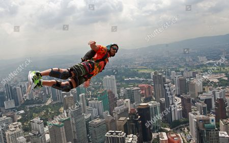 Base Jumper Paul Webster of Australia Jumps From the 380m High Kuala Lumpur (kl) Tower in Kuala Lumpur Malaysia 27 September 2012 Some 100 Base Jumpers From All Over the World Take Part in the Annual Kl Tower International Jump Malaysia Kuala Lumpur