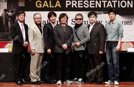 (l-r) Festival Director Lee Yng-kwan South Korean Actors Lee Kyeong-yeong Park Weon-sang Director Chung Ji-young Actors Myung Gye-nam Seo Dong-soo and Kim Jung-gi Pose After the Gala Presentation of the Movie 'National Security: Namyoungdong 1985' by South Korean Director Chung Ji-young at the 17th Busan International Film Festival (biff) in Busan South Korea 06 October 2012 the Biggest Film Festival in Asia Showcases 307 Films From 75 Countries From 04 to 13 October in Busan Korea, Republic of Busan