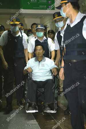 Taiwan's Ex-president Chen Shui-bian (c) is Flanked by Police As He Leaves Taoyuan General Hospital After a Medical Checkup in Taoyuan Northern Taiwan on 11 September 2012 Chen President From 2000 Until 2008 is Serving a 17-and-a-half-year Jail Term For Corruption Chen Supporters Were Demanding President Ma Ying-jeou to Release Chen Or Grant Him Medical Parole Saying Chen's Health is Deteriorating and He Might Die in Jail Soon Taiwan Taoyuan
