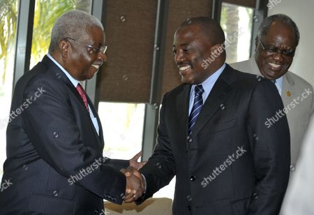 President of the Democratic Republic of Congo Joseph Kabila (c) and the President of Mozambique and the Chairman of the Southern Africa Development Community (sadc) Armando Guebuza (l) Shake Hands As the President of Namibia Hifikepunye Pohamba (r) Smiles During the Sadc Troika Meeting Held in Dar Es Salaam Tanzania 04 September 2012 the Leaders Are Expected to Discuss the Situation in Eastern Democratic Republic of Congo As the Top Agenda Tanzania, United Democratic Republic of Dar Es Salaam