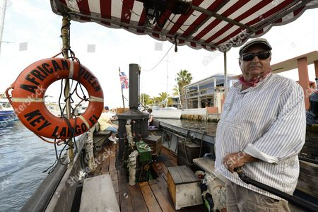 A Picture Made Available on 27 March 2013 Shows Captain Michael Huett Operating the Original African Queen Along a Canal in Key Largo Florida Usa 21 March 2013 the Boat was Built in England in 1912 and Then Used in the Famous 1951 Movie 'The African Queen' Starring Humphrey Bogart and Katharine Hepburn the Steam-operated Boat Has Been Completely Restored and Takes Film Buffs and Tourists on Area Cruises United States Key Largo