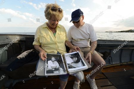 A Picture Made Available on 27 March 2013 Shows Kathy and Paul Reece Looking at Movie Stills While Taking a Cruise on the African Queen in Key Largo Florida Usa 21 March 2013 the Boat was Built in England in 1912 and Then Used in the Famous 1951 Movie 'The African Queen' Starring Humphrey Bogart and Katharine Hepburn the Steam-operated Boat Has Been Completely Restored and Takes Film Buffs and Tourists on Area Cruises United States Key Largo