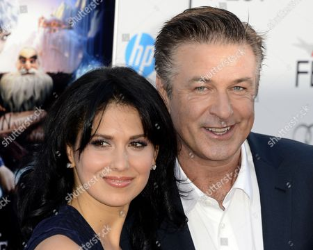 Stock Image of Us Actor and Cast Member Alec Baldwin (r) and His Wife Hilaria Lynn Thomas (l) Arrive For a Screening of the 'Rise of the Guardians' at Grauman's Chinese Theatre in Hollywood California Usa 04 November 2012 'Rise of the Guardians' is an Animated Adventure Tale of a Group of Heroes Each with Extraordinary Abilities United States Hollywood