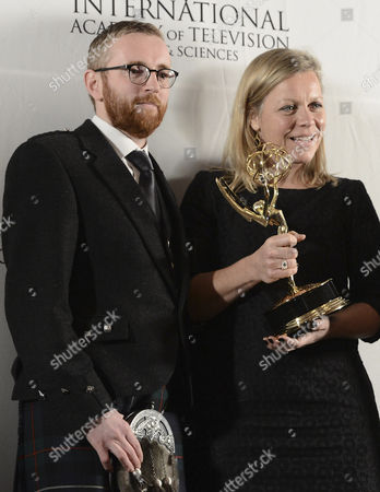 Winner in the Category Documentary Commissioning Editor Charlotte Moore (r) and Executive Producer Craig Hunter (l) of the Film 'Terry Pratchett: Choosing to Die' Hold Their International Emmy During the 40th International Emmy Awards Gala Held at the Hilton Hotel Mercury Ballroom New York City New York Usa 19 November 2012 United States New York City
