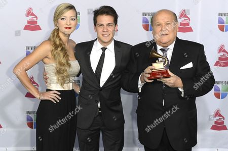 Stock Photo of Argentinian Composer Leo Dan (r) Holds His Lifetime Achievement Award While Posing with His Son (c) and Daughter-in-law (l) in the Press Room During the 13th Annual Latin Grammy Awards in Las Vegas Nevada Usa 15 November 2012 United States Las Vegas